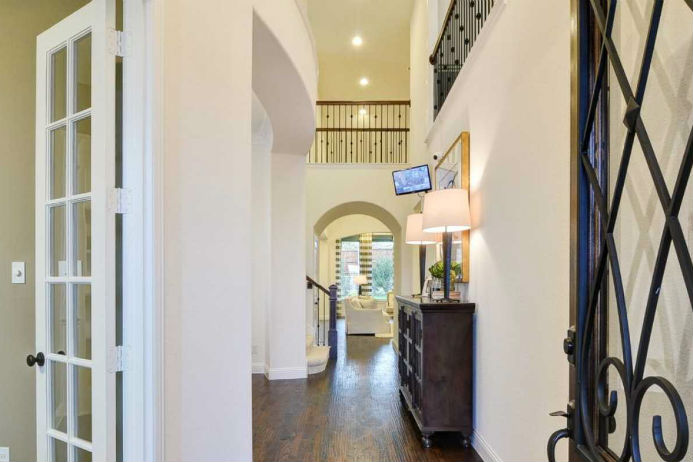 Highland Homes model, entryway with view of loft and archway